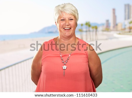 Senior Woman With Hands Behind, Outdoor - stock photo