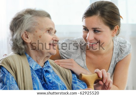 Senior woman with her caregiver - stock photo