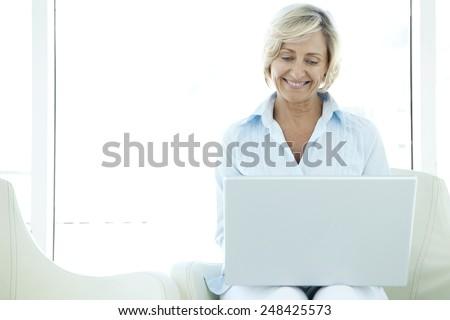 Senior woman with laptop - stock photo