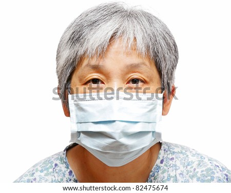 senior woman with protective facemask - stock photo