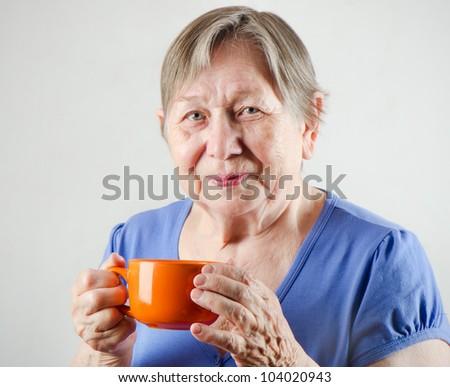 Senior woman with tea cup - stock photo