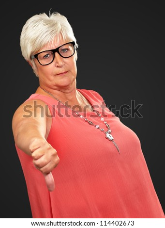 Senior Woman With Thumbs Down Isolated On Black Background - stock photo