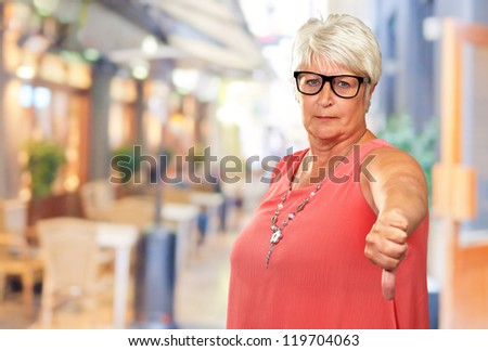 Senior Woman With Thumbs Down, Outdoor - stock photo
