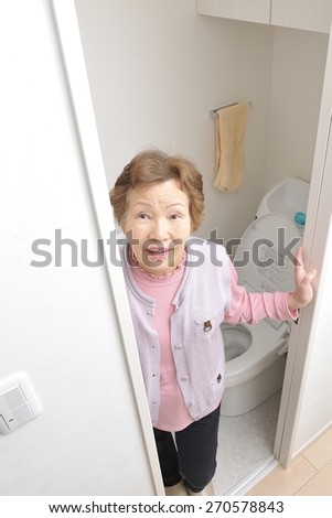 Senior women after using the toilet - stock photo