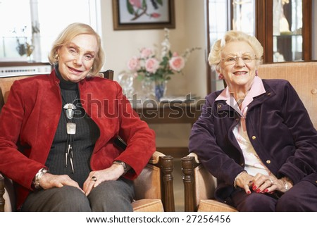Senior women relaxing in armchairs - stock photo