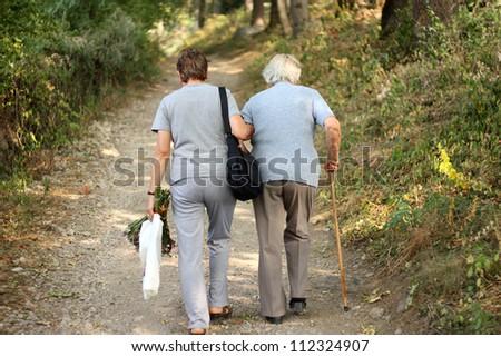 Seniors in park - stock photo