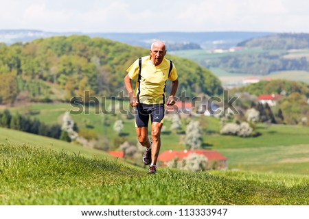 seniors joggers trained for his fitness by jogging - stock photo
