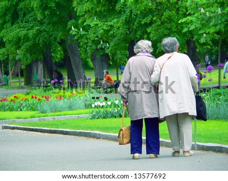 Seniors on walk in park - stock photo