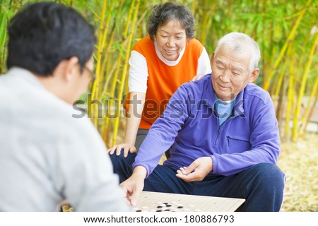 seniors play traditional chinese board game Go - stock photo