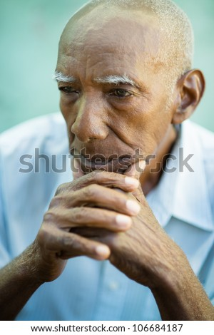 Seniors portrait of contemplative old african american man looking away. Copy space - stock photo