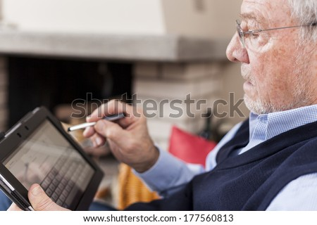 seniors using tablet and smart phone - stock photo