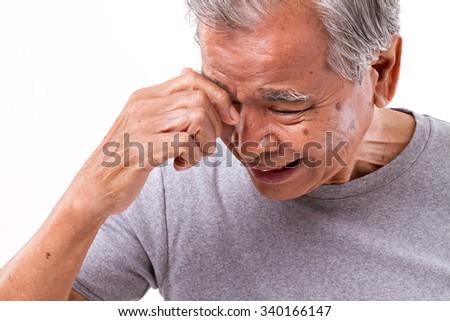 senoir man suffering from headache, stress, migraine - stock photo