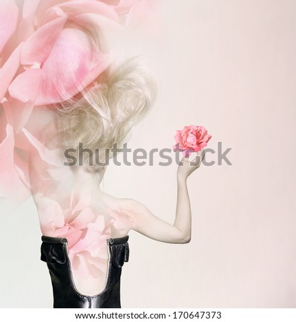 Sensual and sophisticated back of a female model with leather bodice long blond hair and pink roses - stock photo