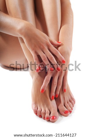 sensual arms and legs with red gel - stock photo