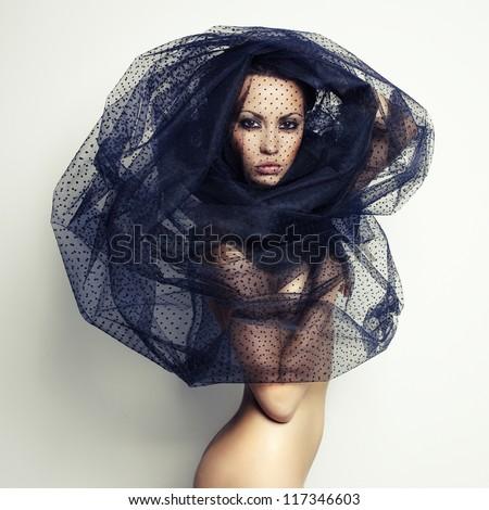 Sensual beautiful woman under the black veil - stock photo