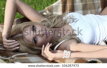 sensual blond woman in lingerie lying on a hammock - stock photo