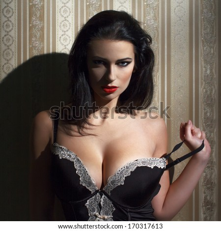 Sensual brunette woman at night portrait, vintage background - stock photo