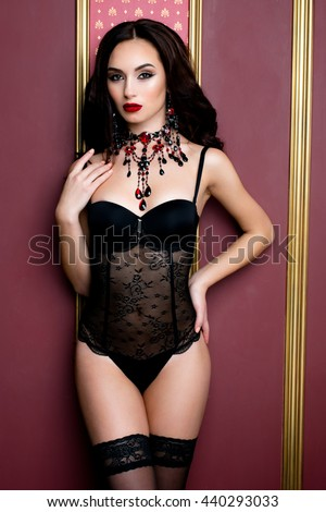 sensual brunette woman with perfect sexy lingerie in vintage room - stock photo