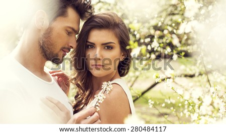 Sensual couple touching each other in the garden - stock photo