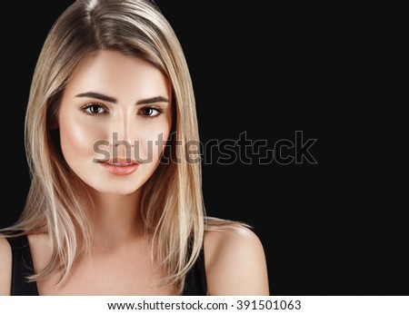 sensual fashion closeup portrait of young pretty woman blond on black  - stock photo