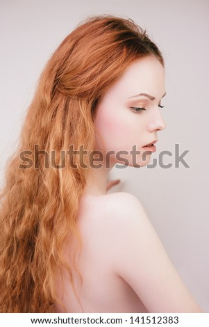 Sensual fashion portrait of young redhead girl with long hair - stock photo