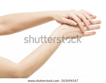 Sensual female hands rubbing each other, isolated on white  - stock photo