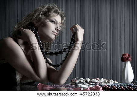 sensual girl sit at the table with accessories - stock photo