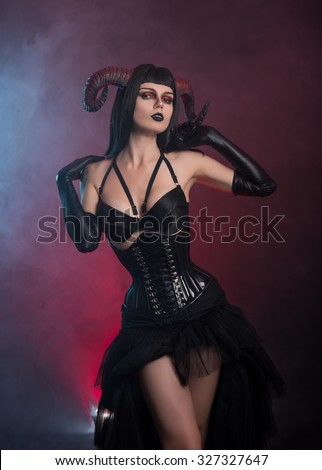 Sensual gothic girl with horns, Halloween theme  - stock photo