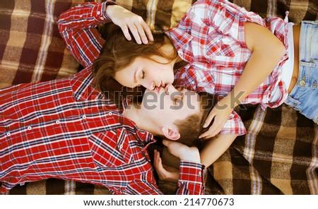 Sensual kiss pretty couple in love - stock photo