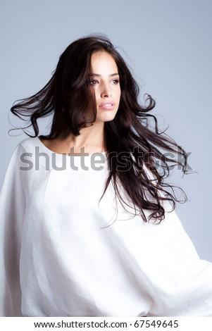 sensual longhair brunette in white, studio shot - stock photo