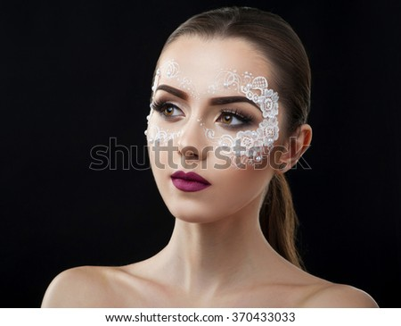 Sensual look. Closeup portrait of a young female wearing artistic makeup with lace attachments copyspace on the side - stock photo