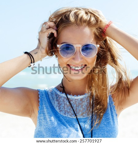 Sensual outdoor summer sunny closeup portrait of pretty young woman in sunglasses having fun outdoor on summer tropic paradise vacation  - stock photo