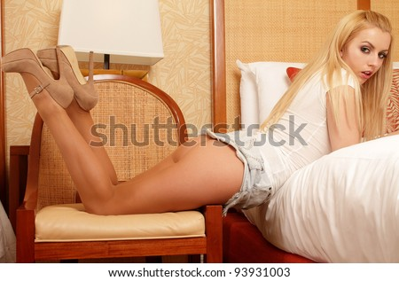 Sensual portrait of beautiful blond in pantyhose and high heels - stock photo