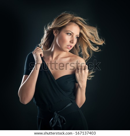 Sensual portrait of blonde woman on black background.  - stock photo