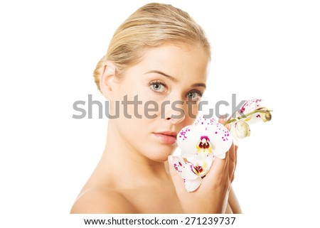 Sensual portrait of nude woman with orchid flower. - stock photo