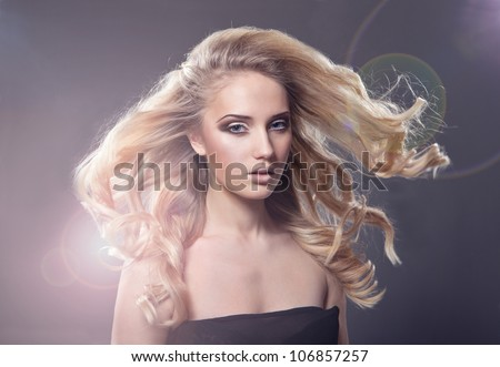 Sensual pretty woman with beautiful long blond hairs - stock photo