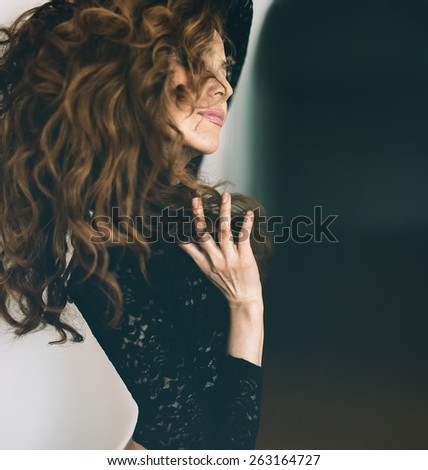 Sensual red-haired Girl with long curly Hair - stock photo