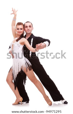 sensual salsa dancing couple on white background. couple of latino dancers making a dance move and posing for the camera - stock photo