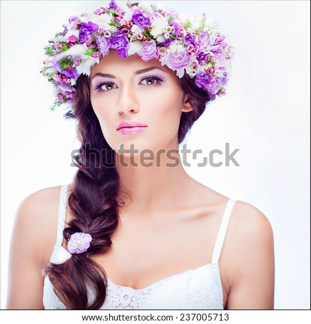 Sensual sexy beautiful curly girl with a floral wreath on her head on white background , close up - stock photo