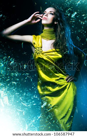 sensual sexy woman in green dress and broken glass - stock photo