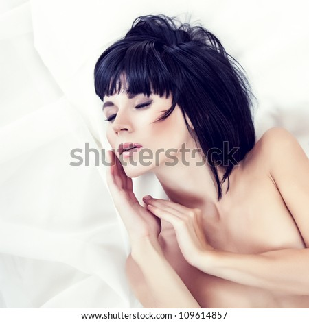 sensual sexy woman sleeping in white bed - stock photo
