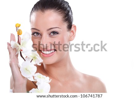sensual spa woman with perfect skin holding orchid - stock photo