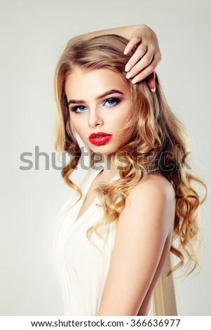 Sensual Woman Fashion Model. Blonde Wavy Hairstyle. Makeup - stock photo