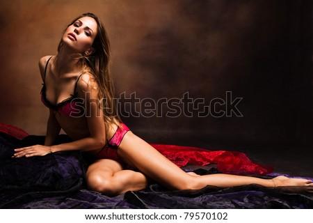 sensual woman in underwear studio shot dark background - stock photo