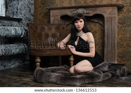 Sensual woman portrait in a vintage interior - stock photo