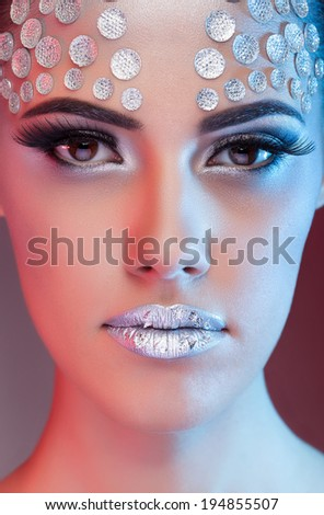 Sensual woman with professional art fashion make up. Blue and red gels used to colors the shadows. Fashion art style. High end retouching. Clean skin with texture - stock photo