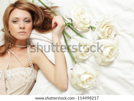 Sensual woman with rose, passion - stock photo