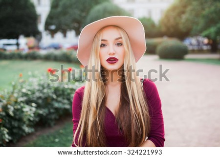 Sensual Young attractive woman face over isolated street urban background,red lips,amazing woman,hairstyle after salon,beauty face,party make-up,summer accessories,perfect bronze tan skin,lovely face - stock photo