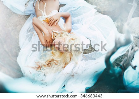 sensual young beauty in water . Soft focus. - stock photo