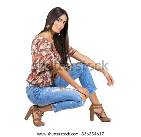 Sensual young brunette in casual clothes looking at camera. Full body length portrait isolated over white studio background.  - stock photo